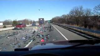 Truck loses load all over highway