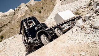Driving an 8x8 Scania G 500 XT with 24 tonnes of marble on steep mountain roads in Carrara, Italy
