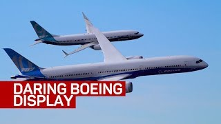 Watch two Boeing jetliners perform synchronized flying