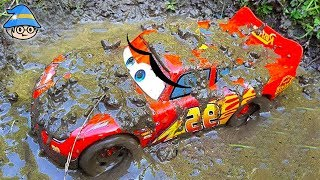 Disney Lightning McQueen fell off the rocky bridge. The car runs in the dirt and water.