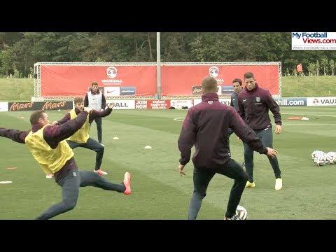 Wayne Rooney slide tackles John Stones in intense practice drill