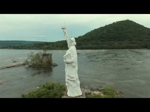Abandoned statue of liberty in the middle of the susquehanna river