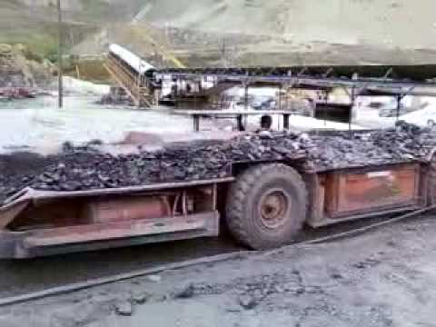 Coal Shuttle Car Doing Its Thing At An Underground Mine Site In Martin County, Kentucky.