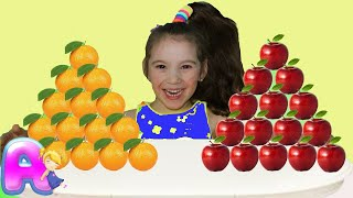 Anna and mammy play in shop apples and oranges
