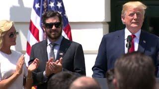 Trump praises NASCAR fans for standing for national anthem