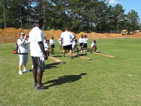 Takeo Spikes and WOLC Football Camp