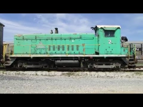 1950's era EMD Diesel Switcher Moving Trash Containers