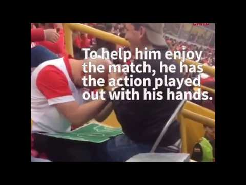 Blind And Deaf Soccer Fan Takes In The Game With Help From His Dad