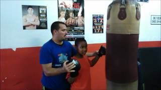 Special Needs Fitness Guru with ADHD training a Non-verbal Autistic Child in Boxing.