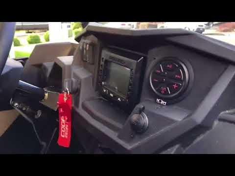 NOAM NUTV5-S Marine stereo system installed on a RZR