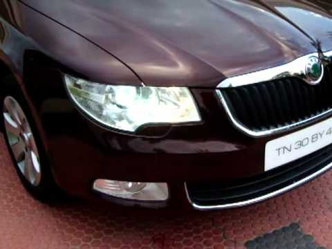 Skoda Superb Features - Head Light Washer, Sun Roof, Auto RV Mirrors