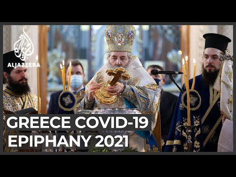 Epiphany: Thousands of Orthodox Christians ignore COVID warnings