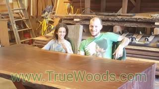 Father and son building a black walnut table.