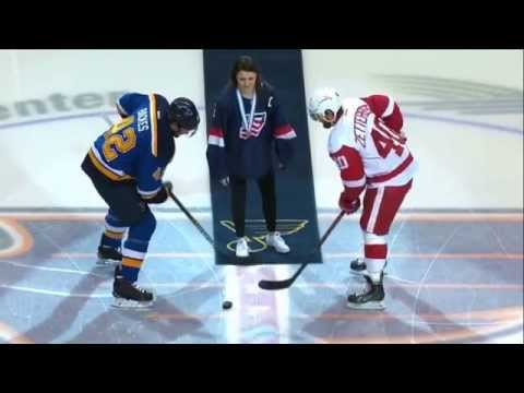 Jincy Dunne drops the ceremonial first puck with David Backes and Henrik Zetterberg