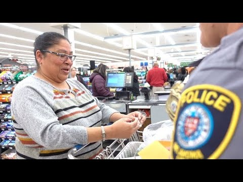 VIDEO: Oklahoma City Police Officers Surprise Shoppers With Gift Cards
