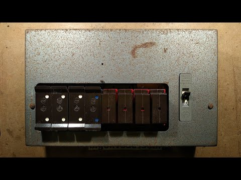 Teardown of an old British Wylex electrical fuse box.  (with bare fuse wires)
