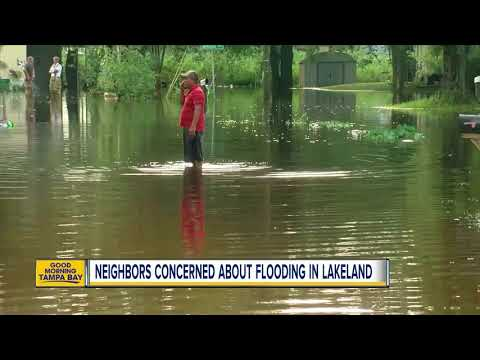 Unseasonable rains have Lakeland residents on edge as flood waters rise from drainage canal