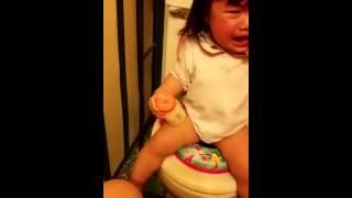 Baby using toilet