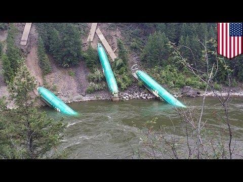 Plane fuselages tumble into Montana river after train derailment