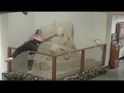Paul Fletcher - Girl Destroys A Sand Sculpture At Royal Hawaiian Hotel