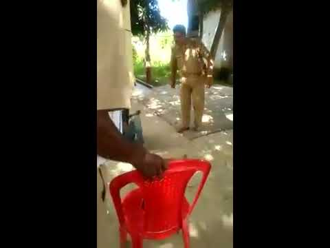 Indian Police beating a boy so badly