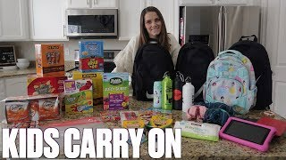 WHAT TO PACK IN YOUR CARRY ON FOR LONG FLIGHTS WITH KIDS | SNACKS, ENTERTAINMENT, PACKING TIPS Video