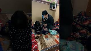 Malini combing Papa