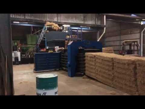 Baler for recycled fiber