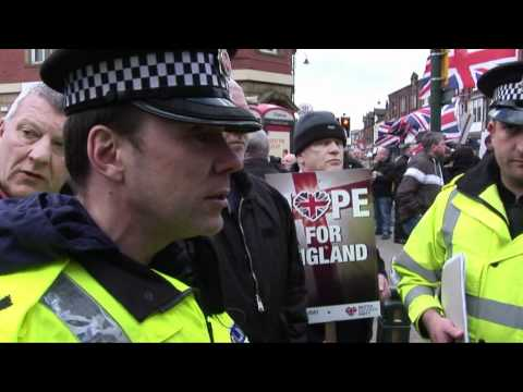 british national party standing up to the police in hyde after muslims say our flags offends them