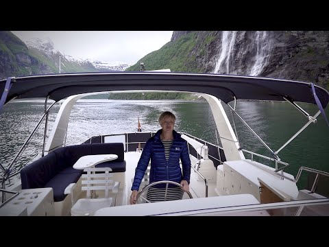 Norwegian girl sail her yacht in breathtaking nature