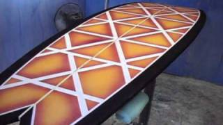 Surfboard building.  Airbrushing surfboards