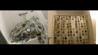 L1 Paraplegic wheelchair user taking shower curtain down & putting it back up again