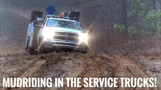 4x4 Ford and Ram service trucks in mud
