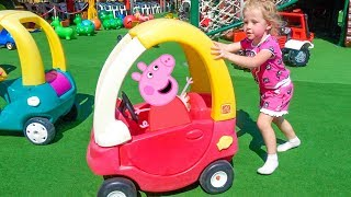 Funny Stacy playing on outdoor playground Family Fun with Jumping Peppa Toys