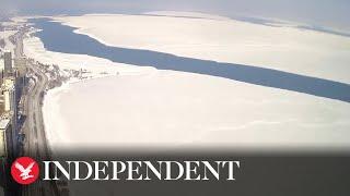 Huge ice sheet breaks off Lake Michigan shoreline