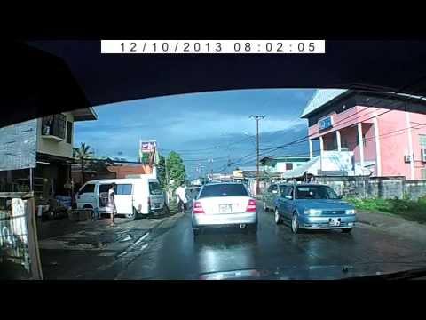 Man chasing woman on Freeport main road, Trinidad and Tobago