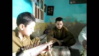 Kid playing rabab (a musical pashto instrument)---2