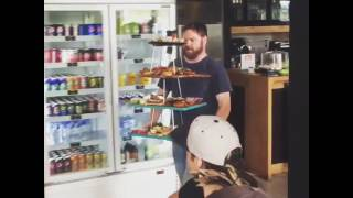 Guy Drops Stack of Food on Table