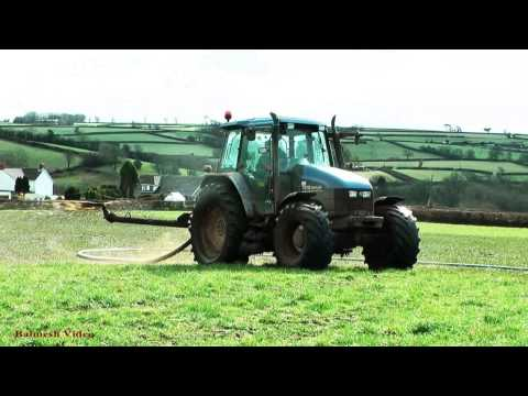 Muck-Spreading on the Hill Top.  -  New Holland Action