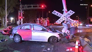 Good Samaritans pull woman from car moments before train crashes into it in Van Nuys   ABC7