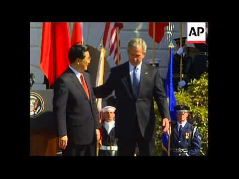 Announcer mis-names China, protestor ejected, Bush pulls Hu''s jacket