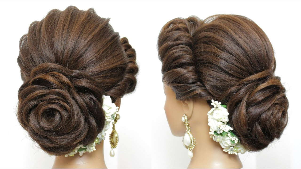 new latest hairstyle with flower bun. bridal updo for girls and