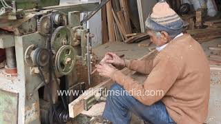Carpentry unit in India - Very old man operates wood drilling machine
