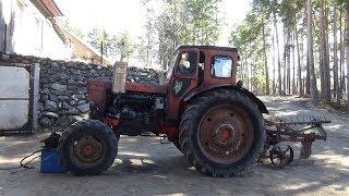 Жөндеу трактор Т-40 АМ ч № 4 ,жасады глушитель.