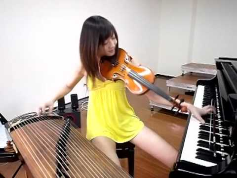 incredible asian girl plays 3 instruments simultaneously