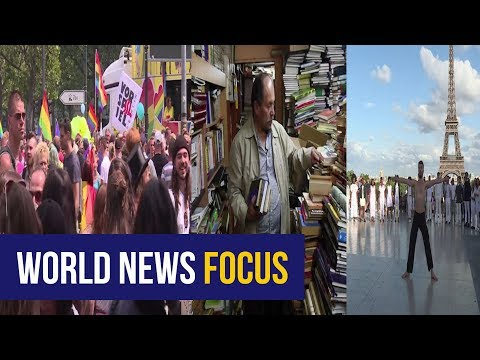 World Focus: Gay marriage legal in Germany, Colombian garbage man's library & Syrian dancer