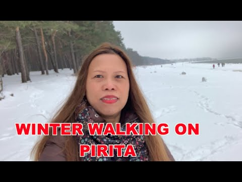 WINTER WALKING ON PIRITA BEACH AT TALLINN ESTONIA EUROPE