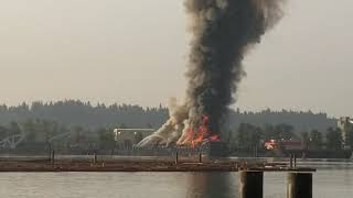 Barge fire on Fraser River New Westminster Surrey