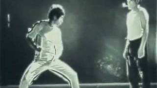 Bruce Lee Lighting Matches with Nunchucks