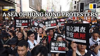 Sea of protesters marches through downtown Hong Kong on July 1 handover anniversary